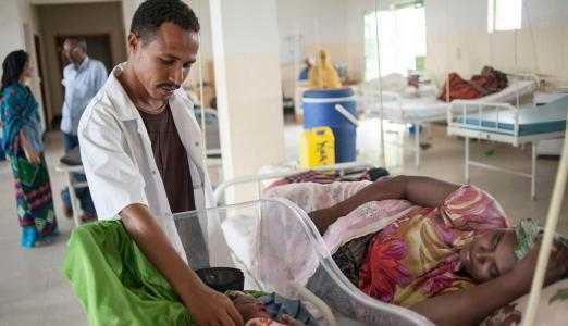 Picture of an Ethiopian health worker with mother and new-born child